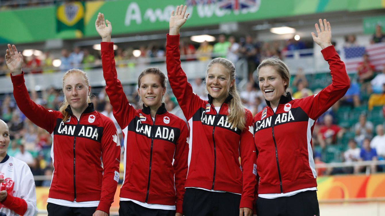 Canada's women's team pursuit team Allison Beveridge, Jasmin Glaesser, Kirsti Lay, and Georgia Simmerling await their bronze medals at the velodrome at the Olympic games in Rio de Janeiro, Brazil, Saturday August 13, 2016.  (photo/ Mark Blinch)