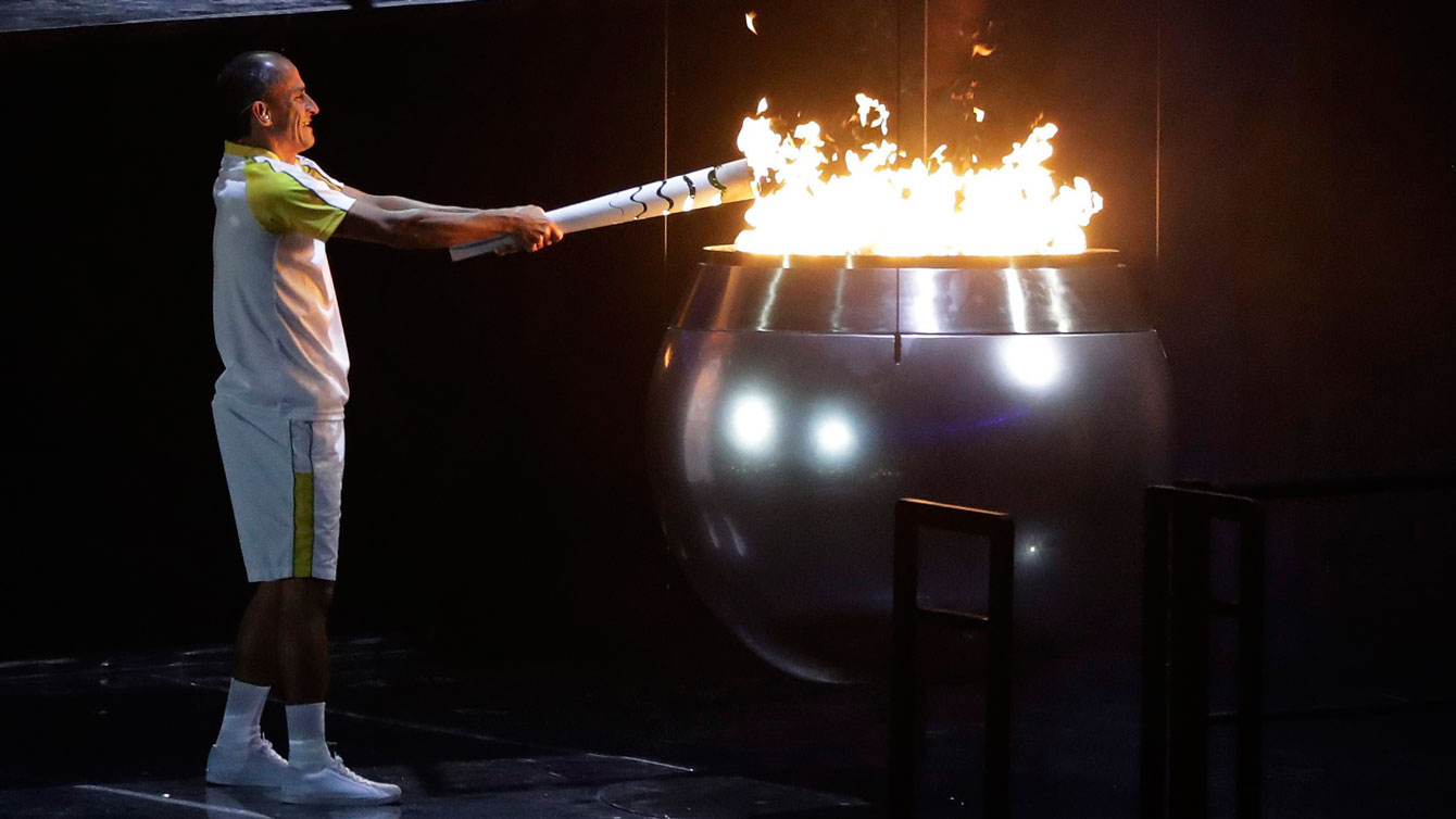 Vanderlei Cordeiro de Lima lights the Olympic flame during the opening ceremony for the 2016 Summer Olympics in Rio de Janeiro, Brazil, Friday, Aug. 5, 2016. (AP Photo/Jae C. Hong)