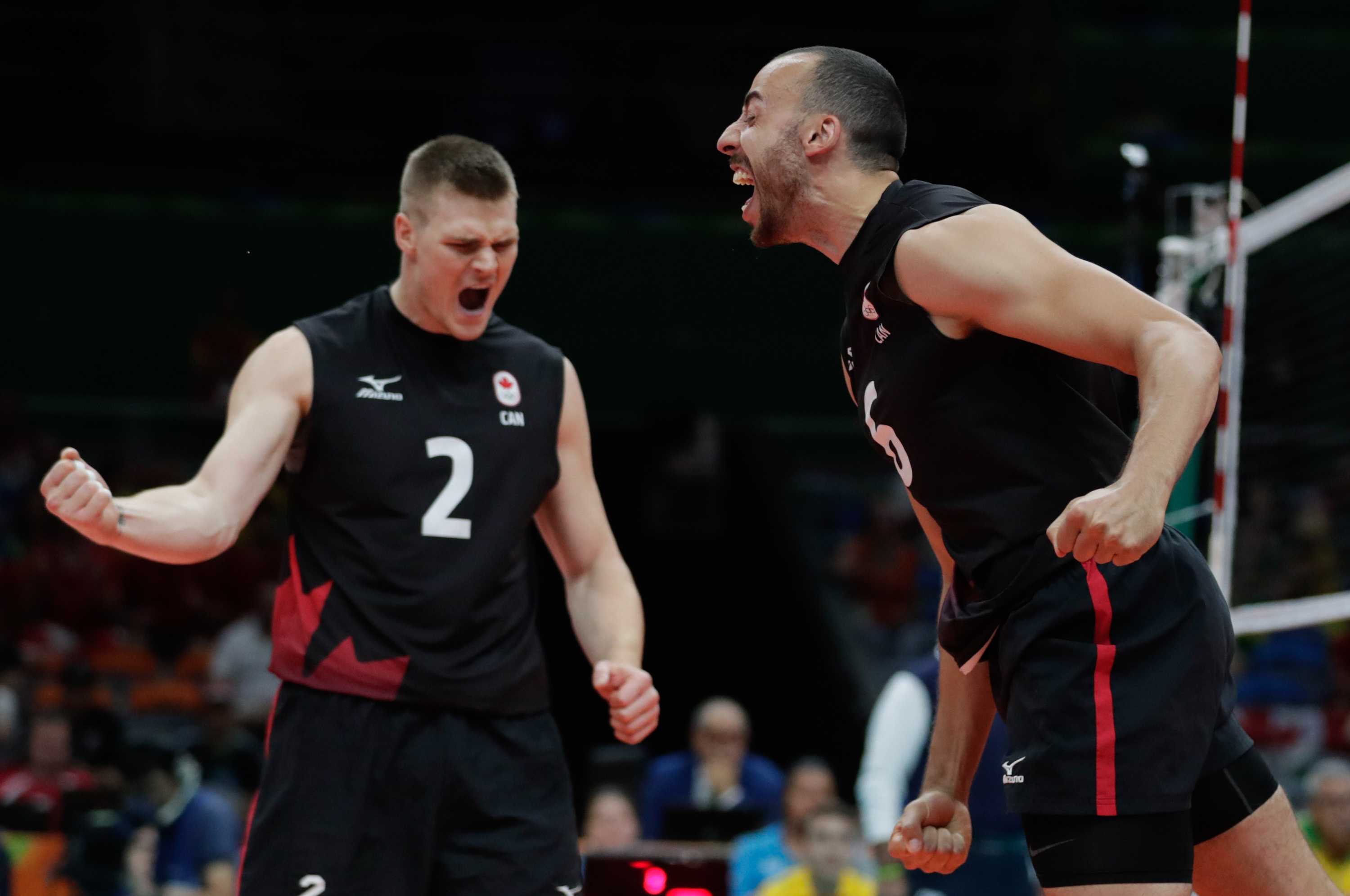 Gord Perrin (left) and Justin Duff during Canada's quarterfinal of the men's volleyball tournament at Rio 2016 (COC/Jason Ransom)