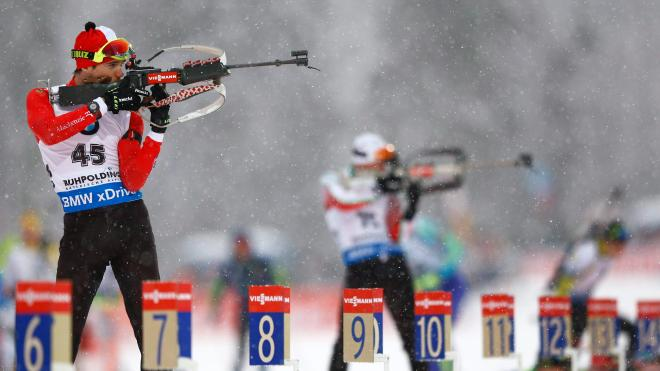 Canada's Nathan Smith shoots at the men's Individual 20 km competition at the Biathlon World Cup in Ruhpolding, Germany, Wednesday, Jan. 13, 2016. (AP Photo/Matthias Schrader)