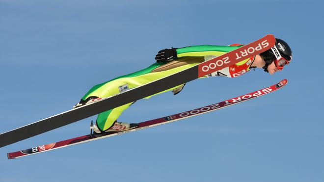 Canada's Taylor Henrich competes during her qualification jump of the Ski Jumping Ladies World Cup in Hinzenbach, Austria, on Sunday, Feb. 7, 2016. (AP Photo/Kerstin Joensson)
