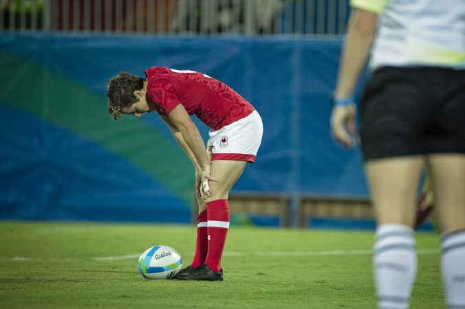 Ghislaine Landry takes a moment to collect herself before kicking off during a match at Rio 2016 (Photo: Paige Stewart).