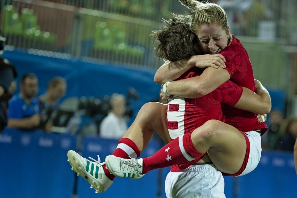 Kayla Moleschi jumps into Ghislaine Landry's arms with excitement after capturing bronze at Rio 2016 (Photo: Paige Stewart).