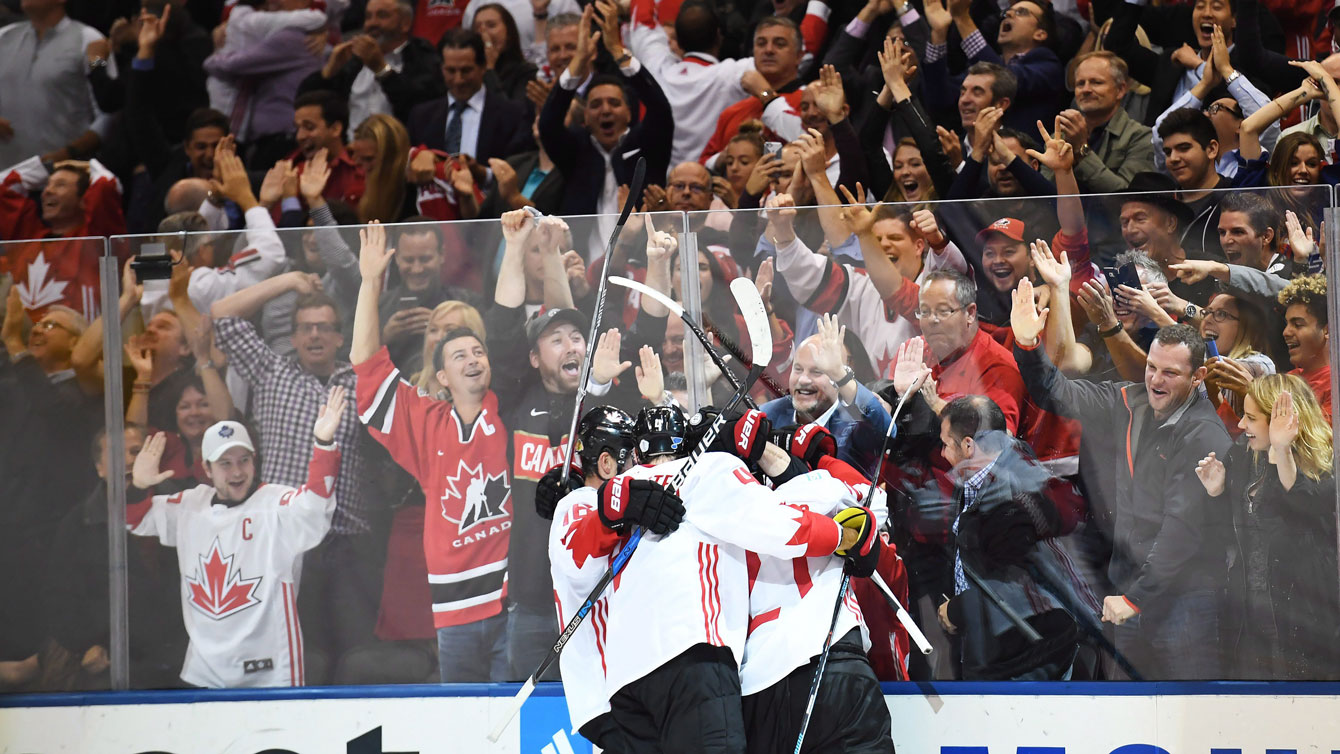 "Canadian men celebrate during one of the gold medal finals at NHL's ""World Cup of Hockey"" in Toronto in September 2016."