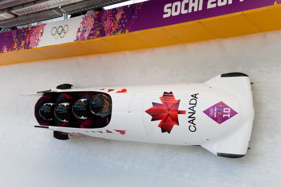 Justin Kripps pilots the Canada 1 sled at Sochi 2014. Photo by Jason Ransom.