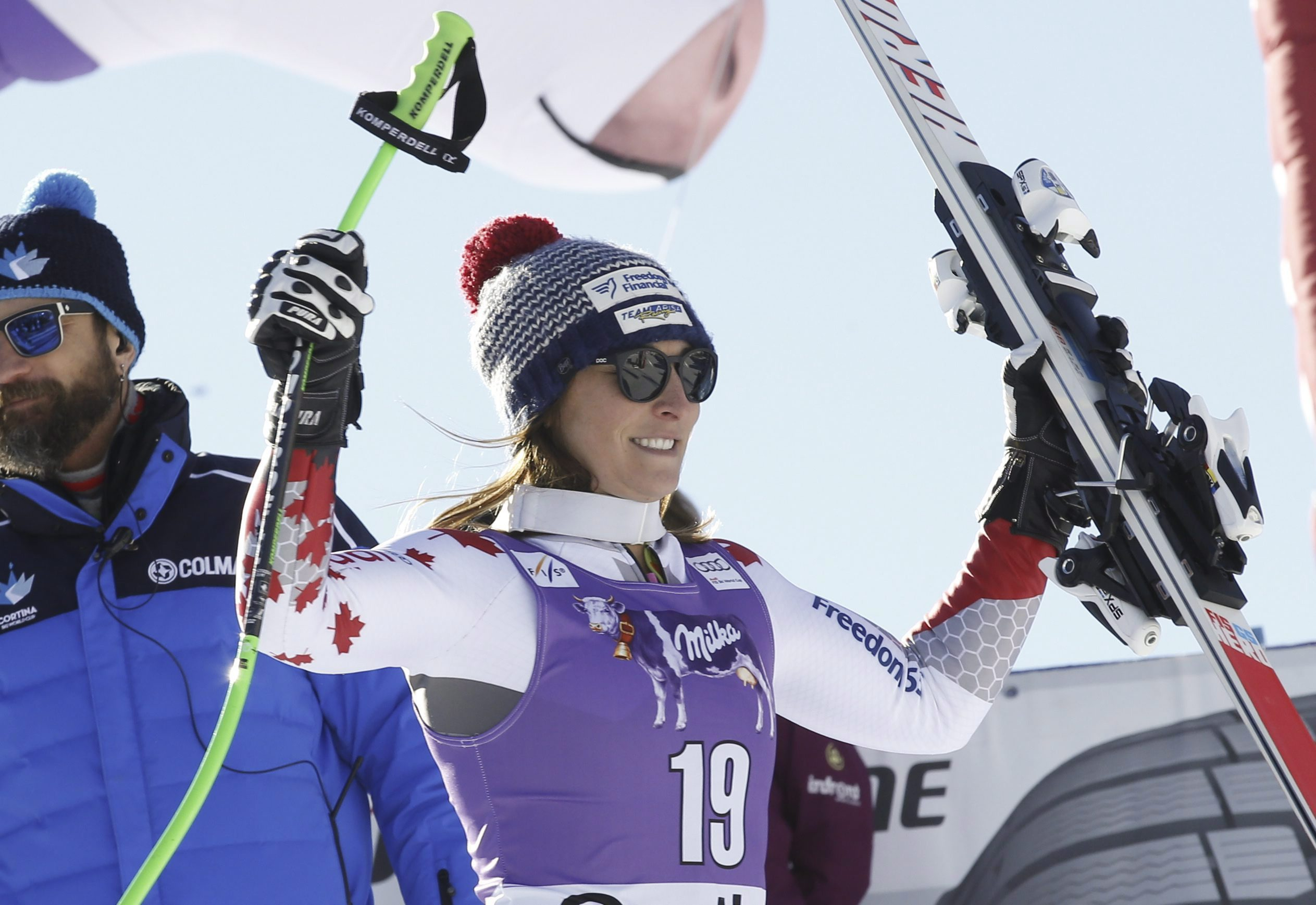 Canada's Larisa Yurkiw celebrates her second place after completing an alpine ski, women's World Cup downhill, in Cortina D'Ampezzo, Italy, Saturday, Jan. 23, 2016. (AP Photo/Armando Trovati)