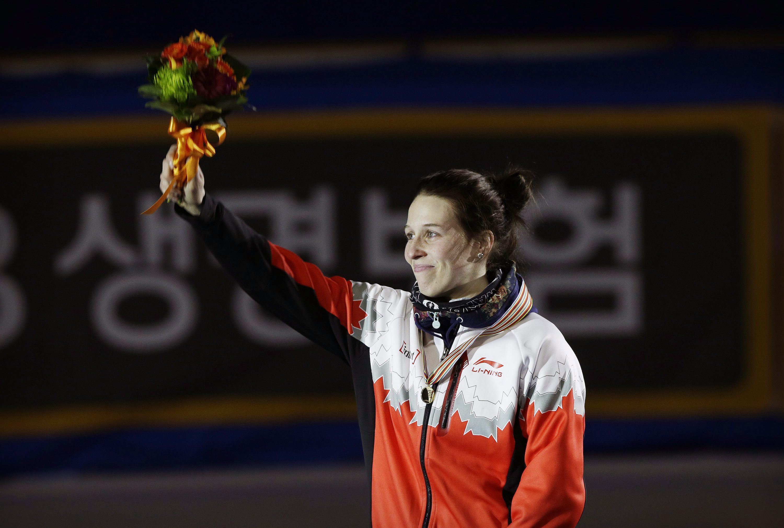 Gold medalist Marianne St-Gelais of Canada celebrates during the awards ceremony of the women's 1500 meter final at the ISU World Cup Short Track Speed Skating in Seoul, South Korea, Saturday, March 12, 2016. (AP Photo/Ahn Young-joon)