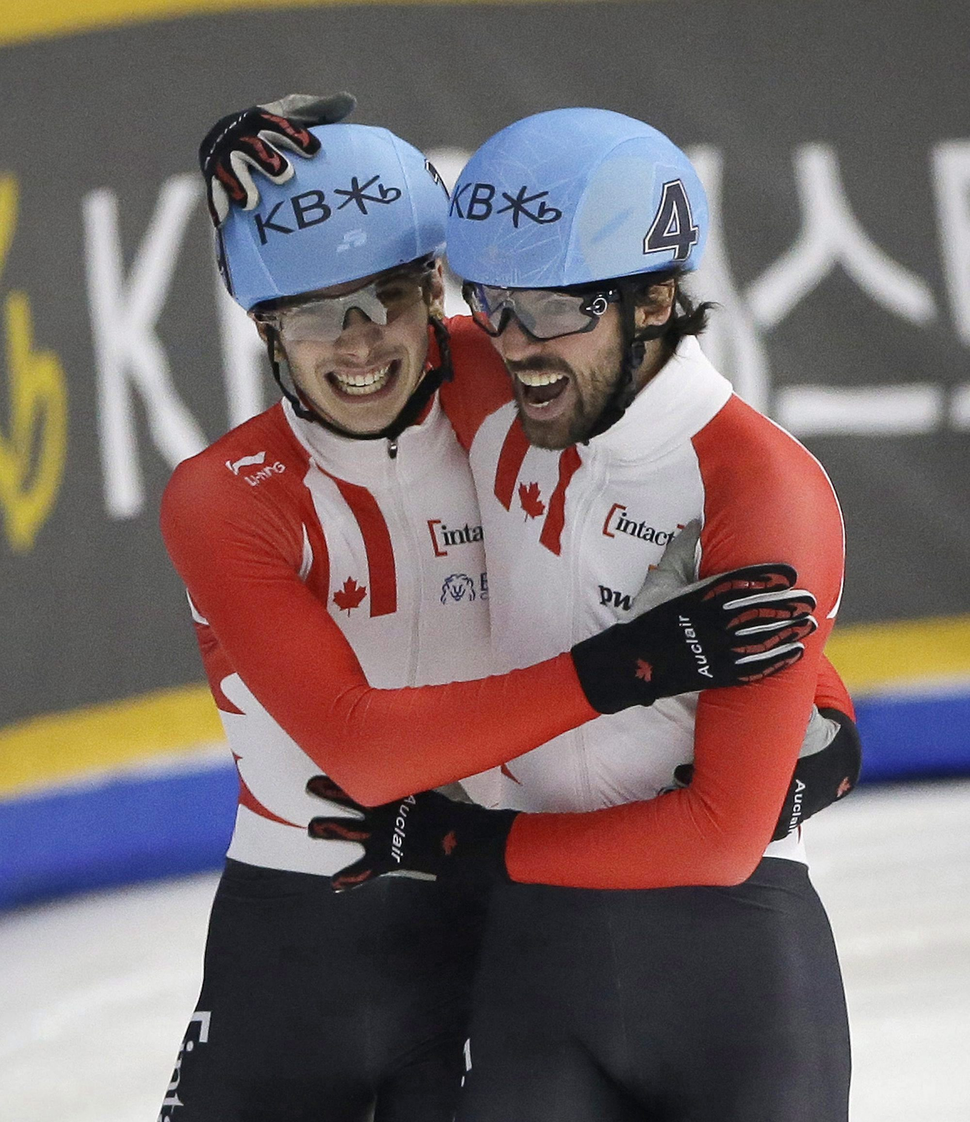 Charles Hamelin, right, and Samuel Girard of Canada celebrate after the men's 1000 meter final race at the ISU World Cup Short Track Speed Skating competition in Seoul, South Korea, Sunday, March 13, 2016. Hamelin won the race while Girard took second. (AP Photo/Ahn Young-joon)