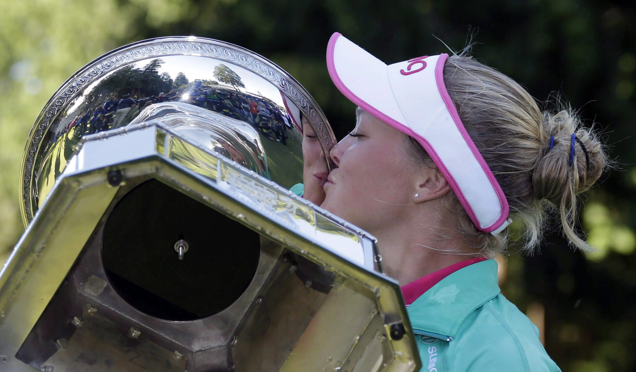After being prompted by organizers, Brooke Henderson, of Canada, plants a kiss on the championship trophy after winning the Women's PGA Championship golf tournament at Sahalee Country Club on Sunday, June 12, 2016, in Sammamish, Washington. The 19-year-old from Smiths Falls, Ont., packed more into one season than some golfers experience over an entire career. THE CANADIAN PRESS/AP, Elaine Thompson