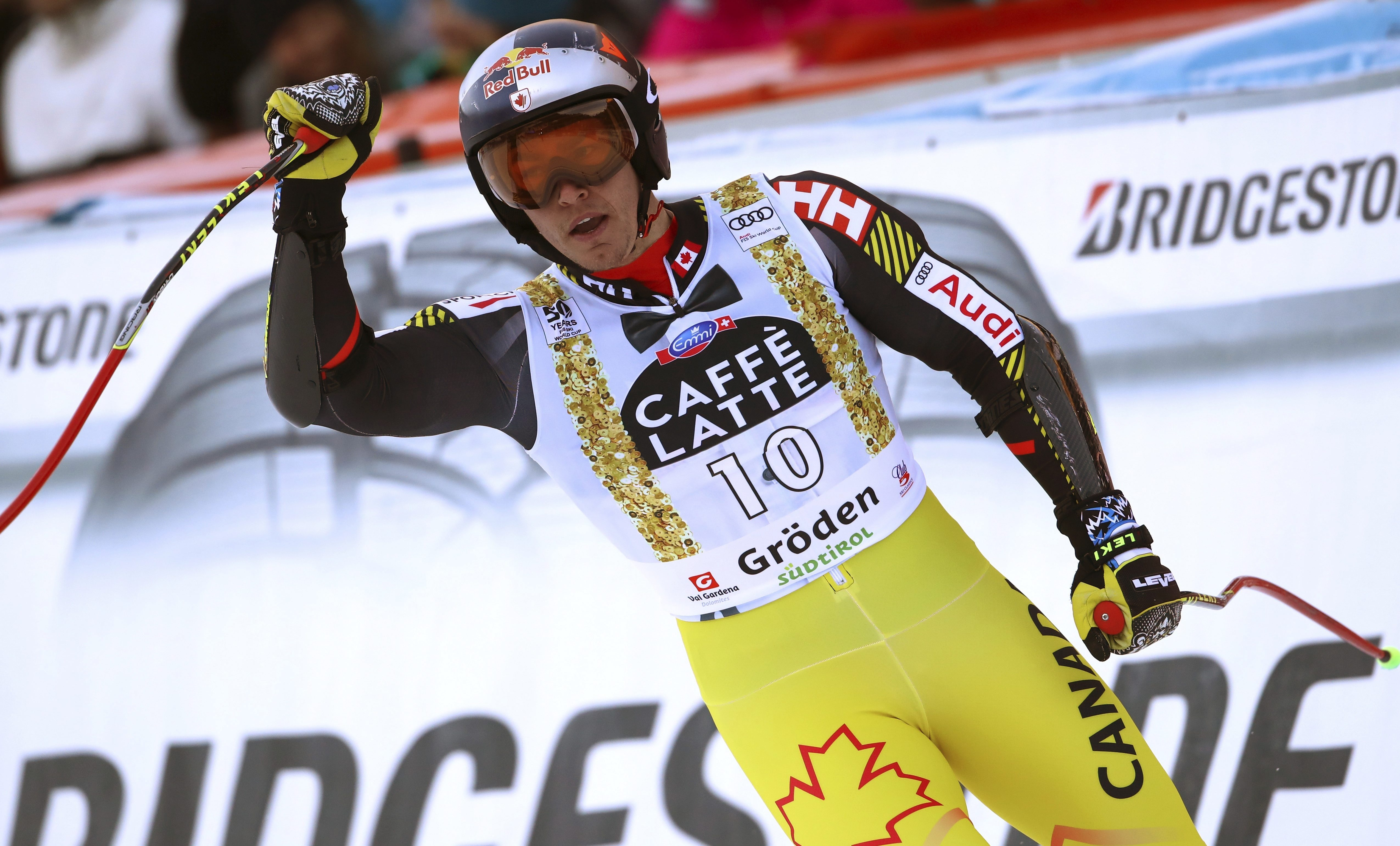 Canada's Erik Guay celebrates after completing an alpine ski, men's World Cup super-G, in Val Gardena, Italy, Friday, Dec. 16, 2016. (AP Photo/Alessandro Trovati)
