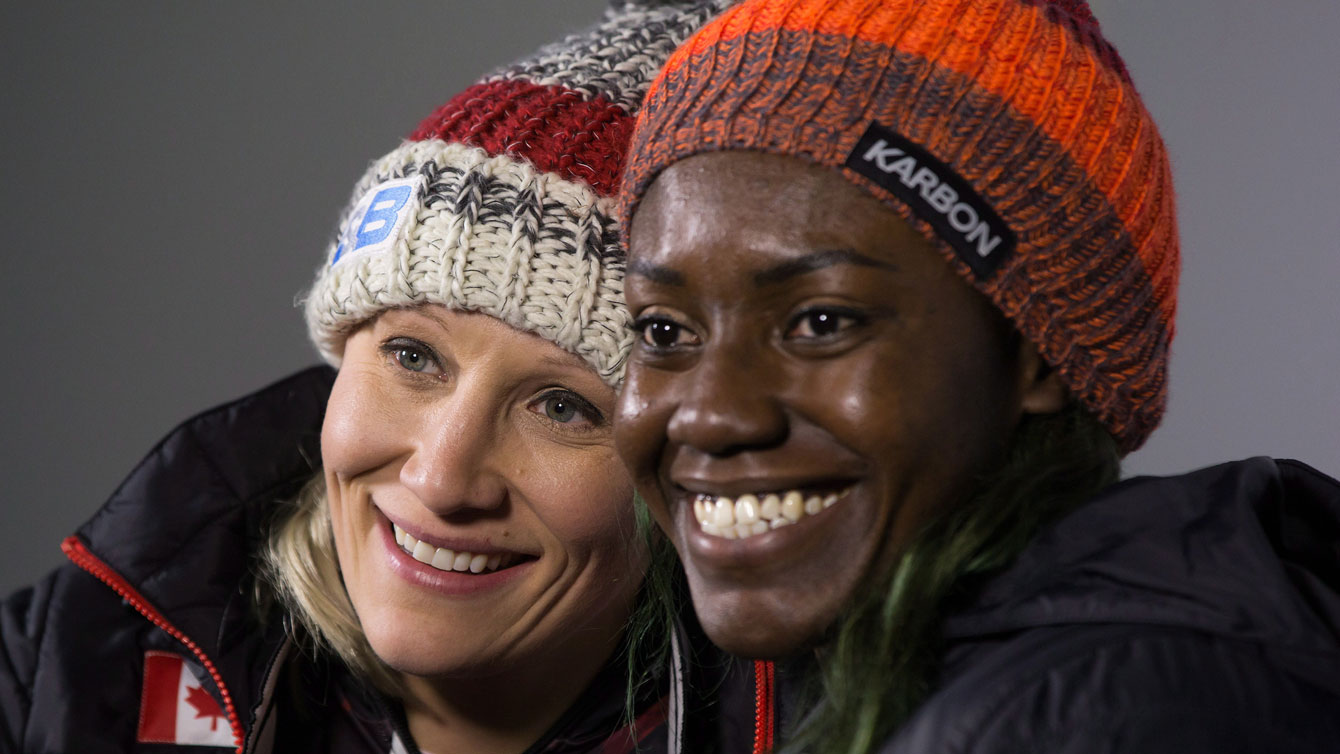 Kaillie Humphries and Cynthia Appiah pose after racing to World Cup gold in Whistler on December 3, 2016. THE CANADIAN PRESS/Darryl Dyck