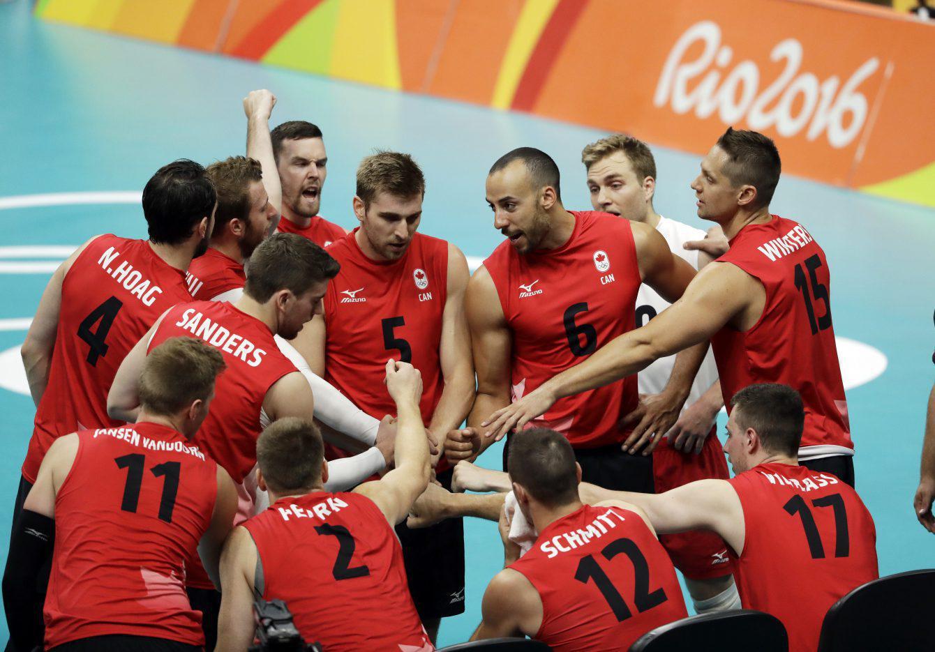 Canada's volleyball team celebrates round robin win against Mexico at Rio 2016 on Saturday, August 13, 2016. (AP Photo/Matt Rourke)