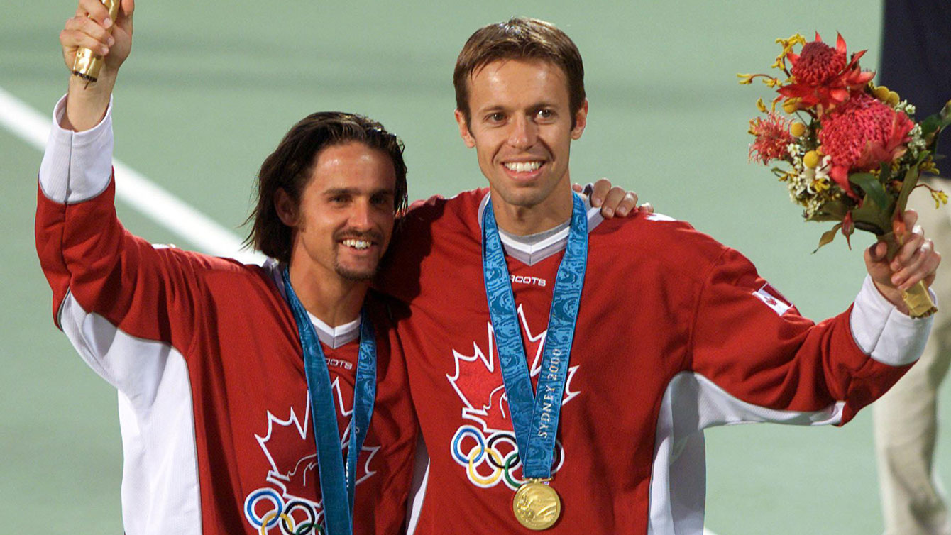 Sebastien Lareau and Daniel Nestor celebrate their men's doubles Olympic gold at Sydney 2000. (CP PHOTO/Ryan Remiorz)