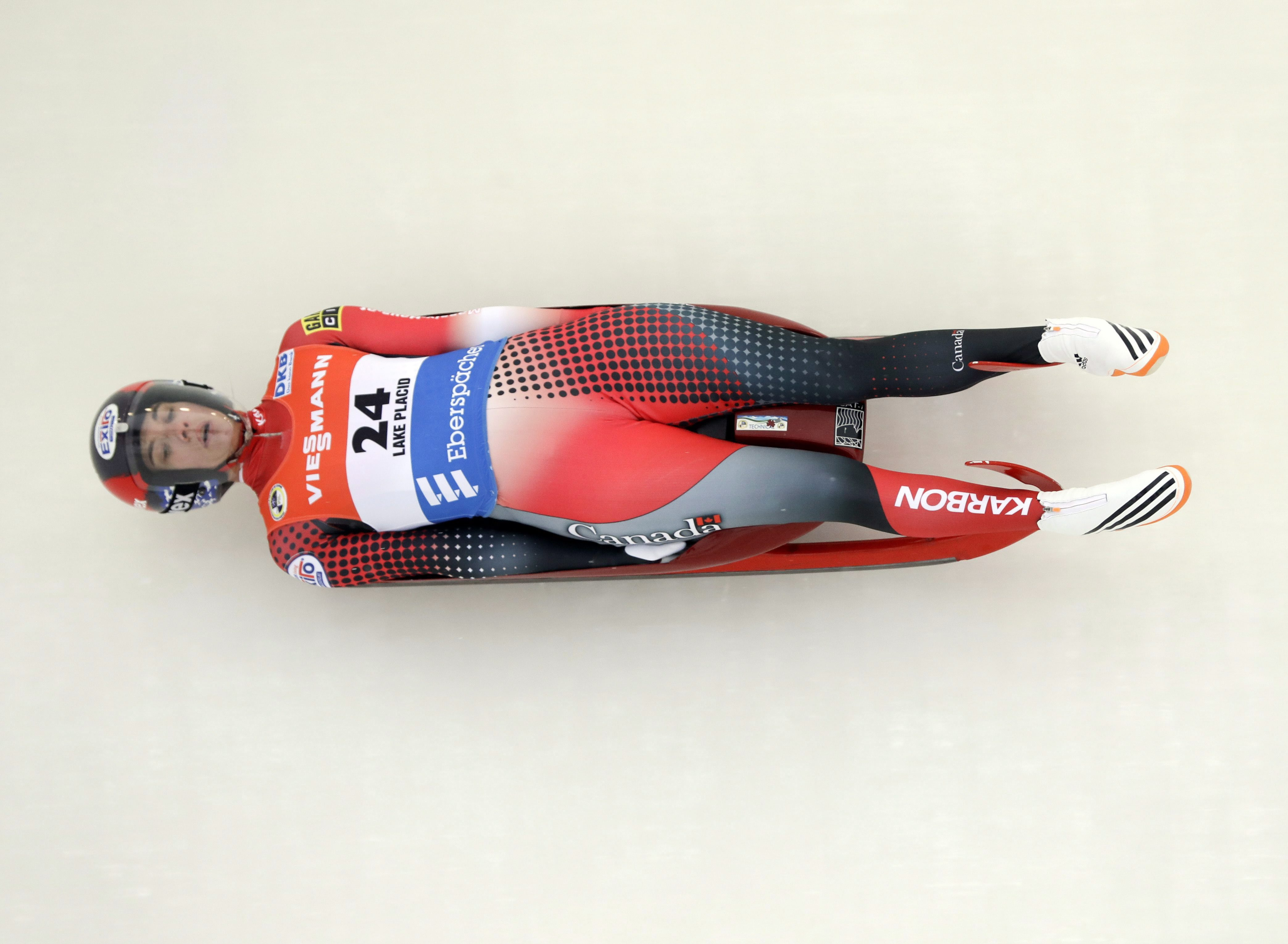 Kimberley McRae, of Canada, competes in the women's luge World Cup race on Saturday, Dec. 3, 2016, in Lake Placid, N.Y. (AP Photo/Mike Groll)
