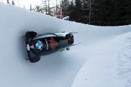 Kaillie Humphries and Melissa Lotholz from Canada speed down the course during the women' two-man bobsled World Cup in St. Moritz, Switzerland, Saturday, Jan. 21, 2017. (Urs Flueeler/Keystone via AP)