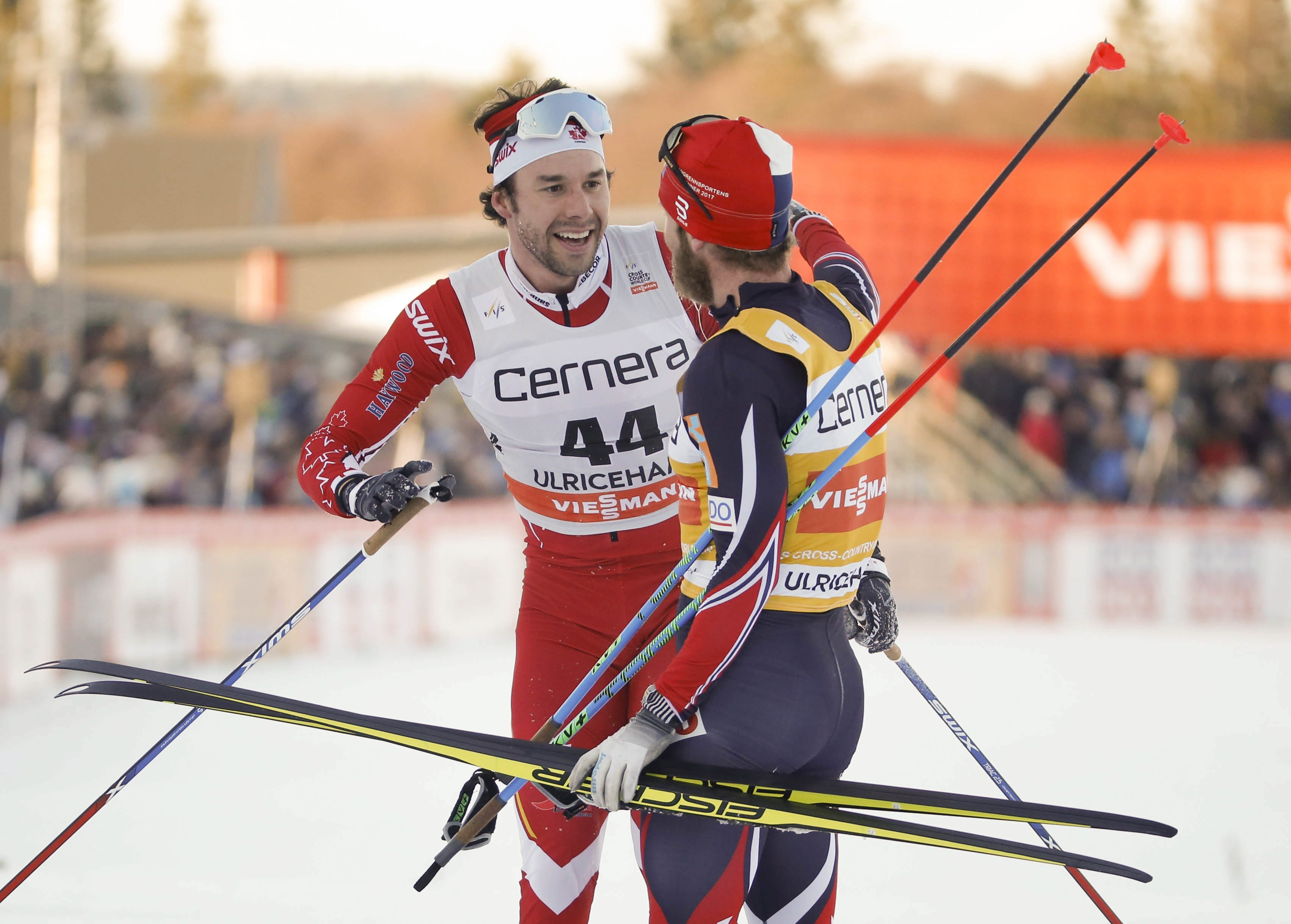 Alex Harvey of Canada, left, is congratulated by Norway's Martin Johnsrud Sundby after winning the men's 15km free style competition at the FIS Cross Country skiing World Cup event in Ulricehamn, Sweden, Saturday Jan. 21, 2017. (Adam Ihse / TT via AP)