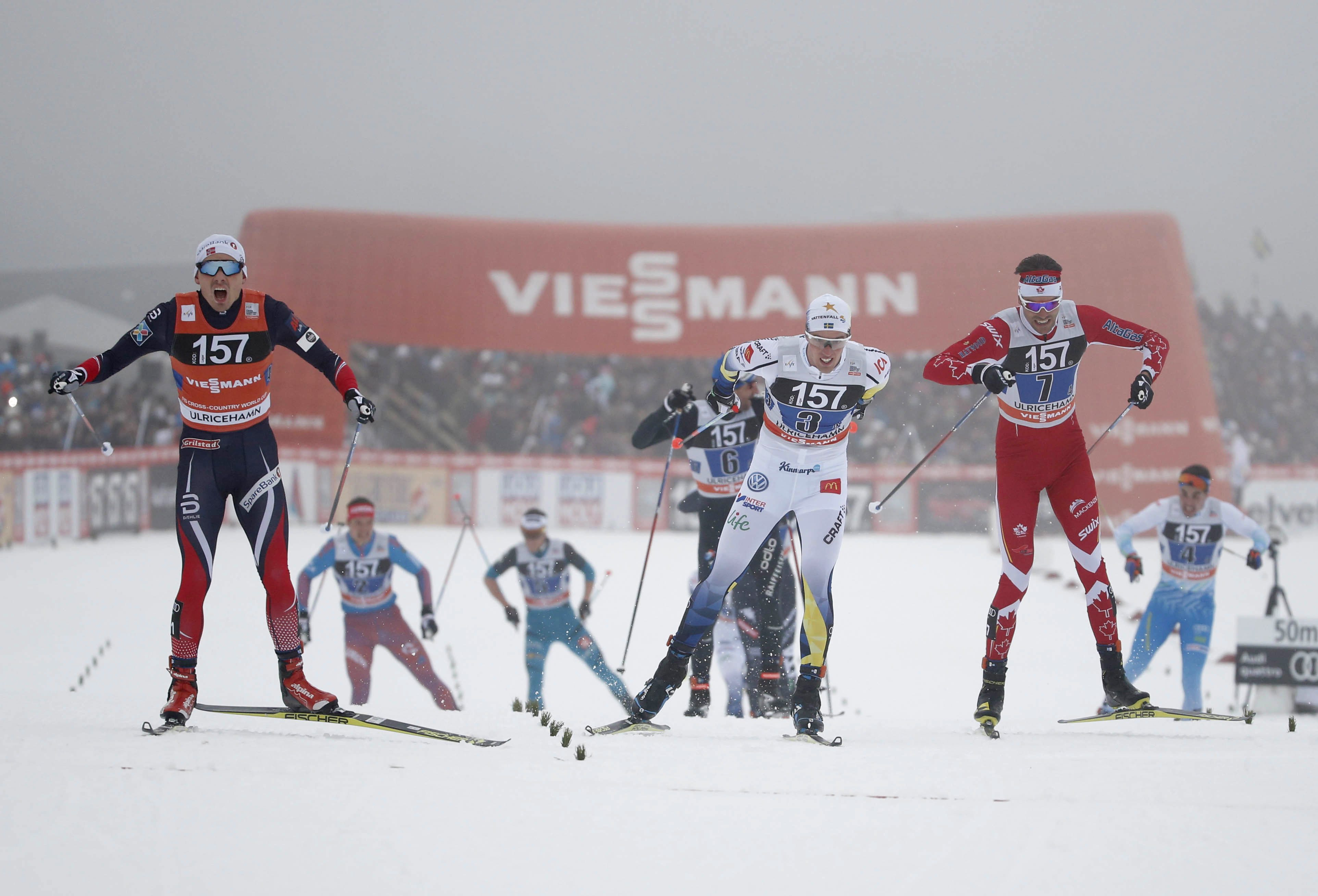 Norway's Finn Haagen Krogh, left, wins in front of Sweden's Calle Halfvarsson, centre, and Len Valjas of Canada, right, during men's relay 4x7.5 km competition at the FIS Cross Country skiing World Cup event in Ulricehamn, Sweden, Sunday Jan. 22, 2017. (Adam Ihse / TT via AP)
