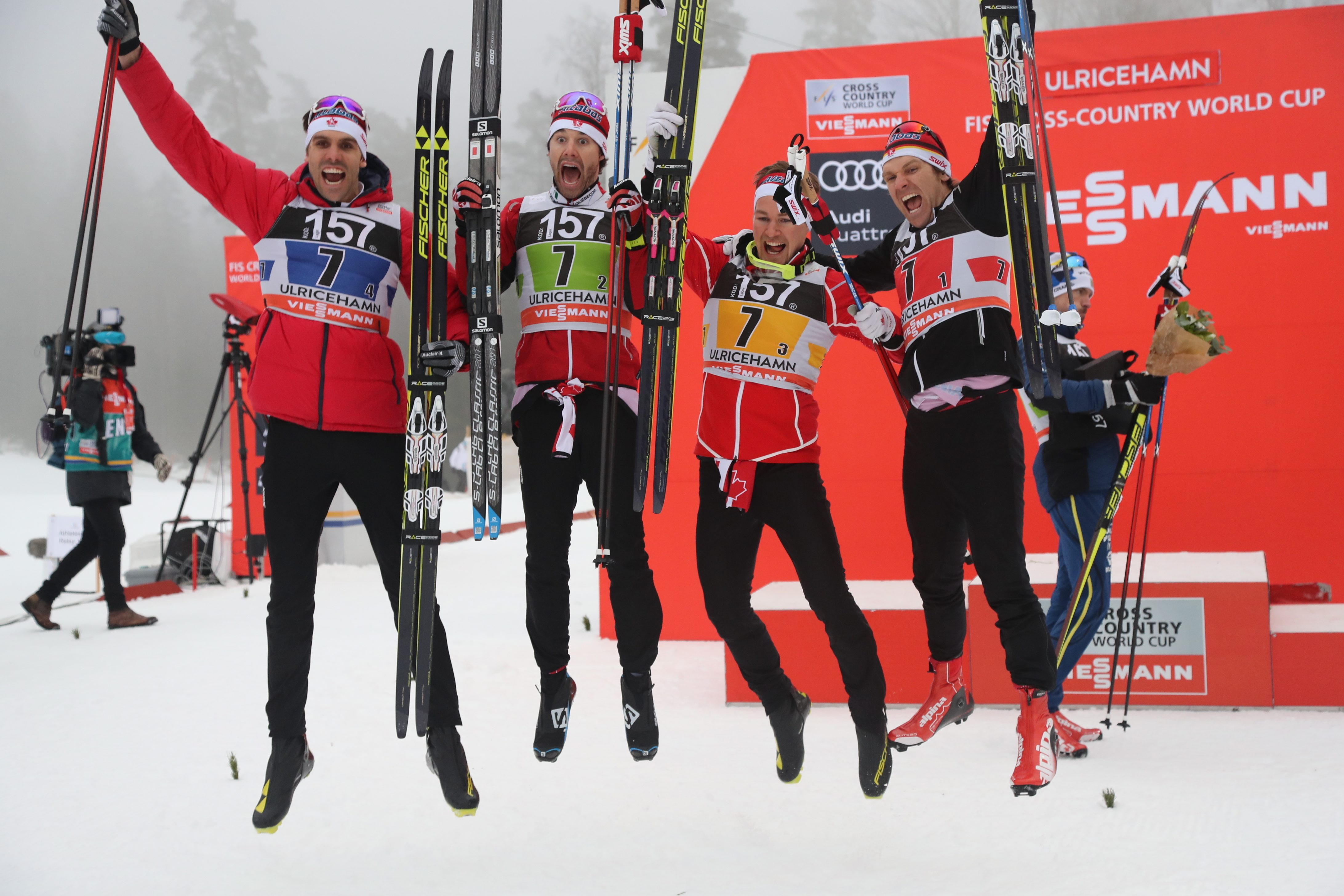 Team of Canada, from left, Len Valjas, Alex Harvey, Knute Johnsgaard and Devon Kershaw celebrate their third place in men's relay 4x7.5 km competition at the FIS Cross Country skiing World Cup event in Ulricehamn, Sweden, Sunday Jan. 22, 2017. (Adam Ihse / TT via AP)