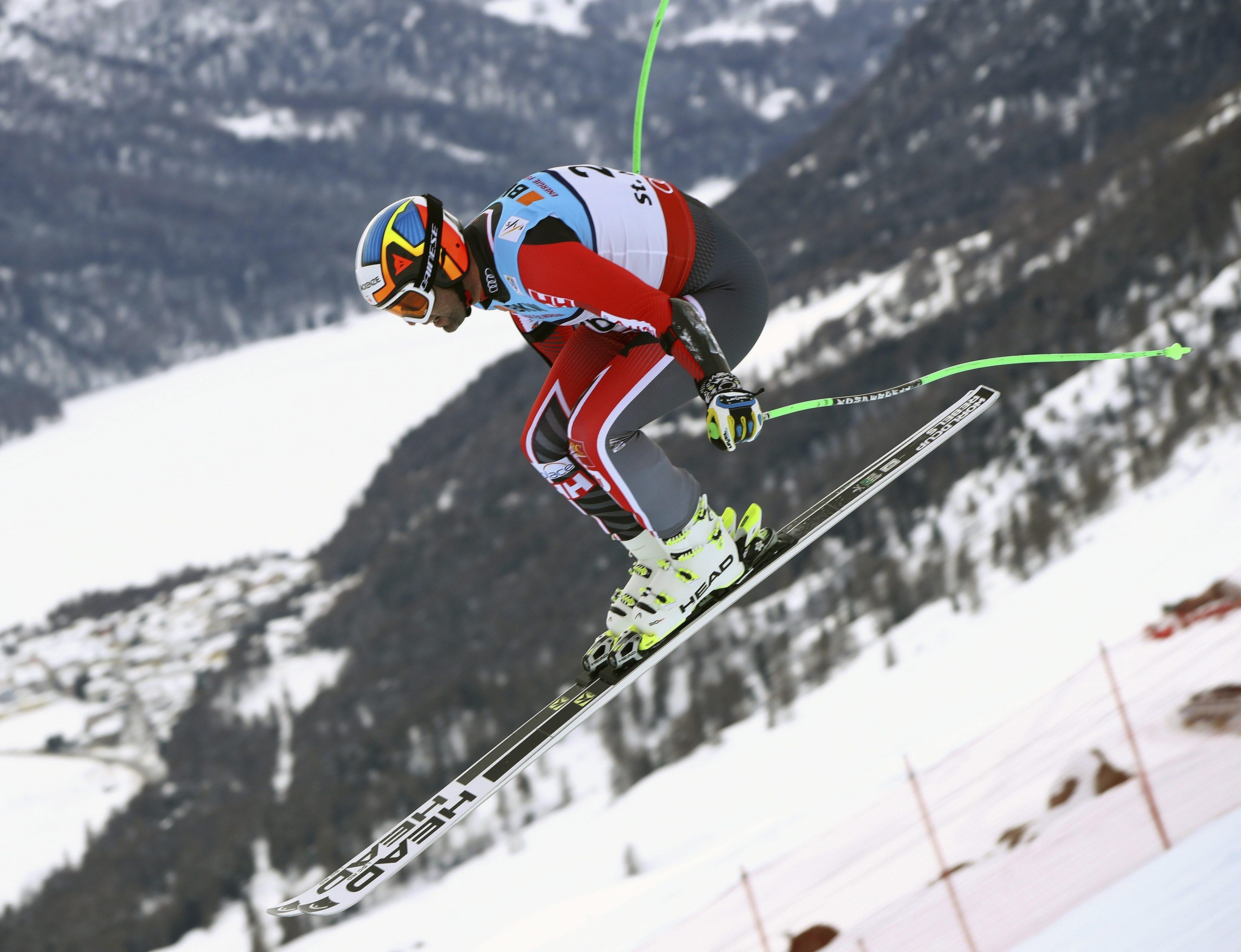 Canada's Manuel Osborne Paradis is airborne during a men's super-G, at the alpine ski World Championships, in St. Moritz, Switzerland, Wednesday, Feb. 8, 2017. (AP Photo/Alessandro Trovati)