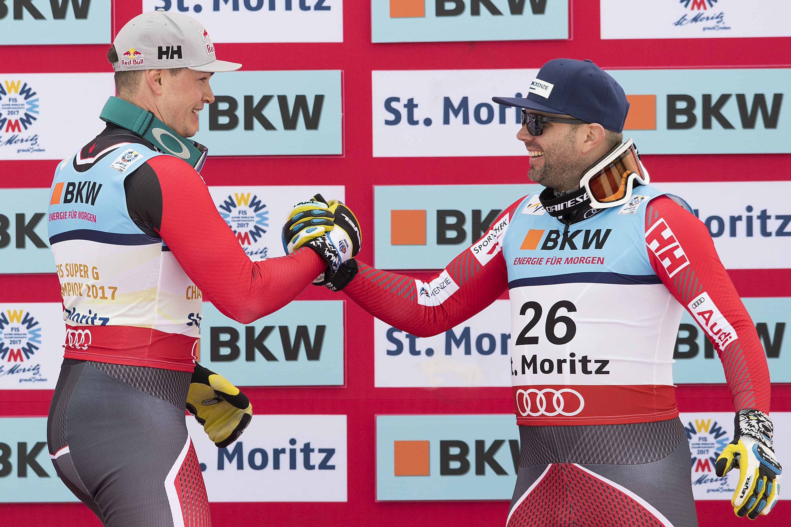 Gold medalist Erik Guay of Canada, left, and bronze medalist Manuel Osborne-Paradis of Canada, right, shake hands during the men's Super-G flower ceremony at the 2017 Alpine Skiing World Championships in St. Moritz, Switzerland, Wednesday, Feb. 8, 2017. (Peter Schneider/Keystone via AP)