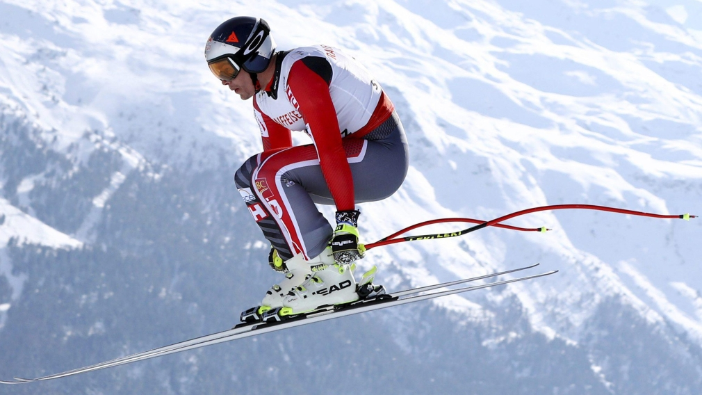 Erik Guay competes during a men's downhill race