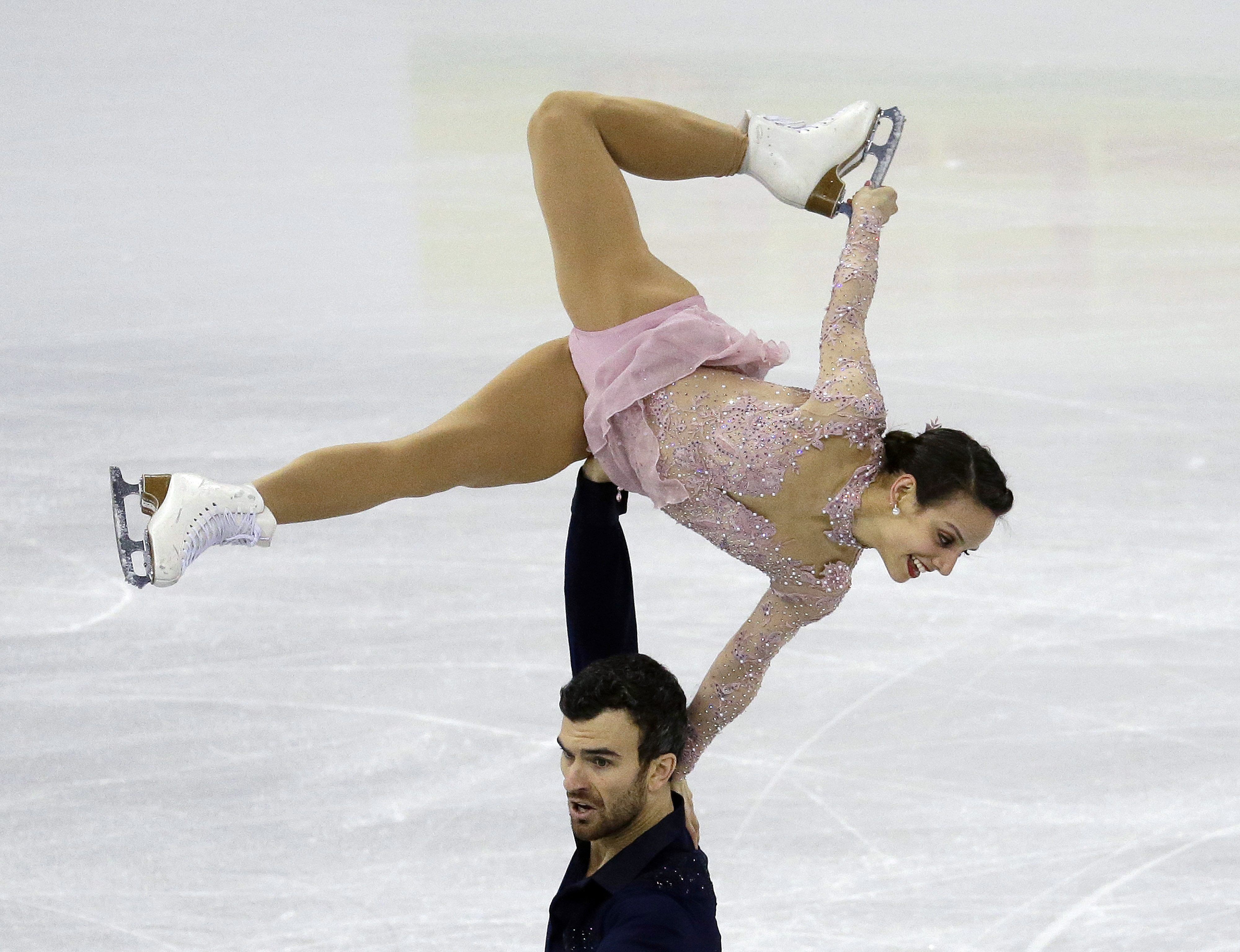 Silver medalists Meagan Duhamel and Eric Radford of Canada perform in the Pairs Free Skating at the ISU Four Continents Figure Skating Championships in Gangneung, South Korea, Saturday, Feb. 18, 2017. (AP Photo/Ahn Young-joon)