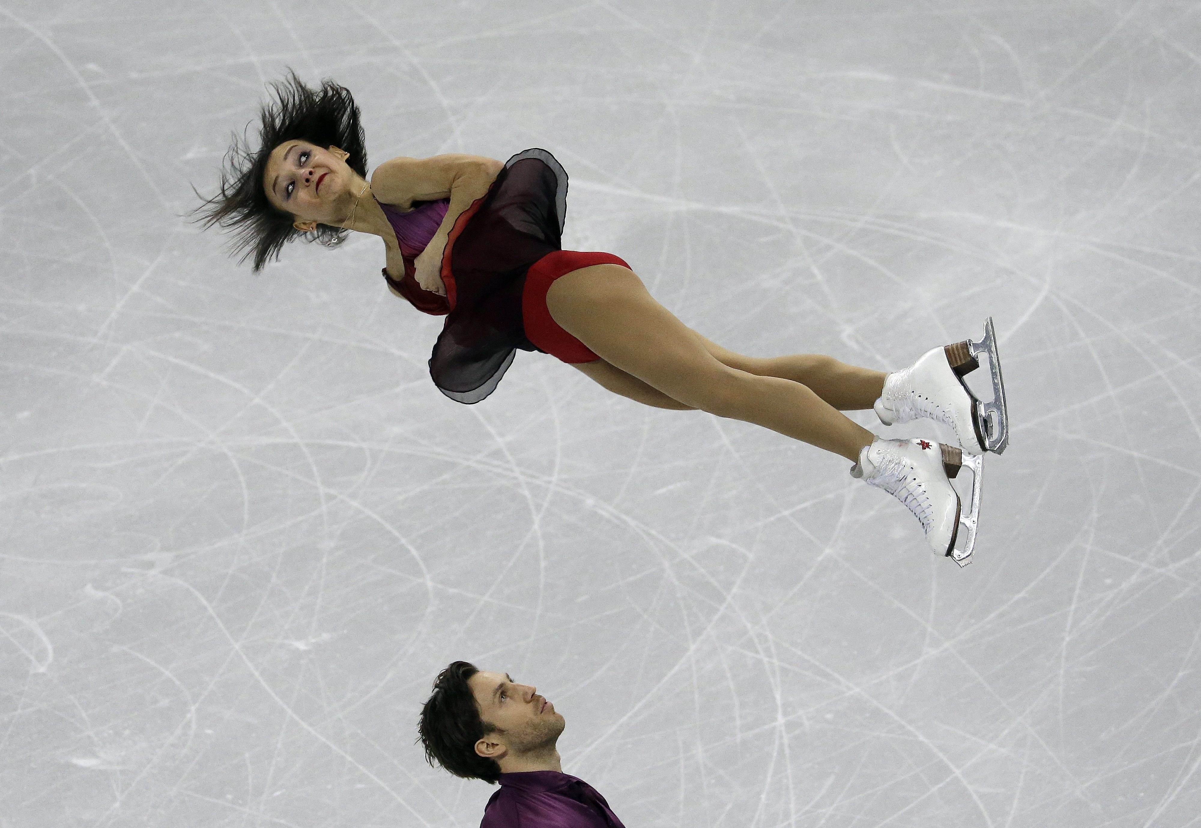 Bronze medalists Lubov Ilyushechkina and Dylan Moscovitch of Canada perform in the Pairs Free Skating at the ISU Four Continents Figure Skating Championships in Gangneung, South Korea, Saturday, Feb. 18, 2017. (AP Photo/Ahn Young-joon)