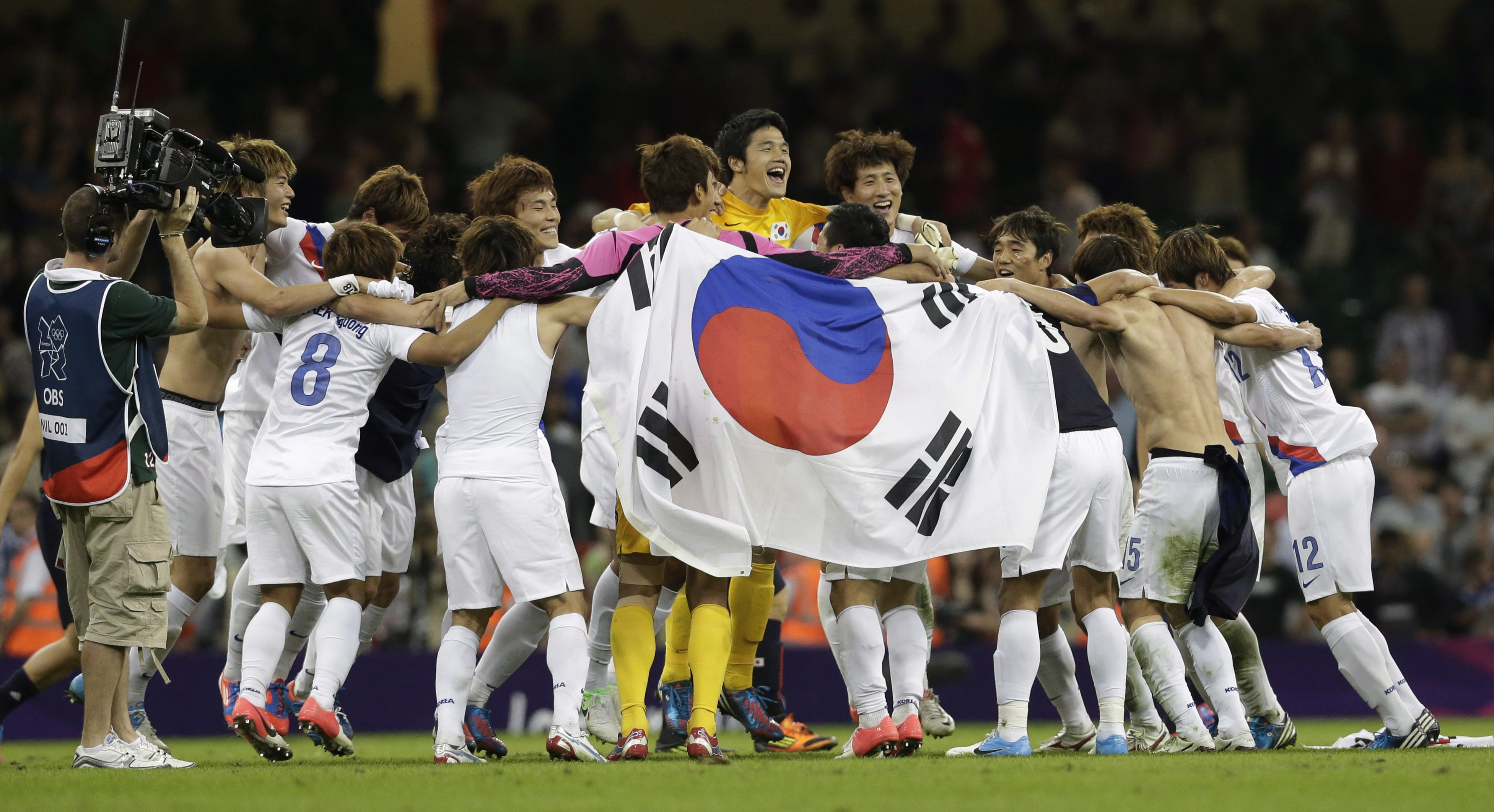 South Korea's players celebrate after winning their men's soccer bronze medal match against Japan, in Cardiff, Wales, at the 2012 London Summer Olympics, Friday, Aug. 10, 2012. South Korea won 2-0. (AP Photo/Luca Bruno)