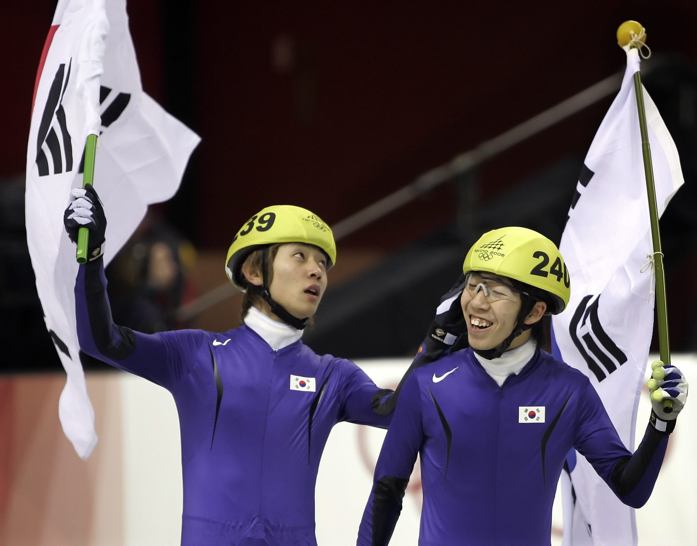 Olympic gold medalist Korea's Ahn Hyun-Soo, left, congratulates his teammate silver medalist Lee Ho-Suk after Hyun-So's gold medal victory in the Men's Short Track Speedskating 1500 meter race at the Turin 2006 Winter Olympic Games in Turin, Italy, Sunday, Feb. 12, 2006. (AP Photo/Eric Gay)