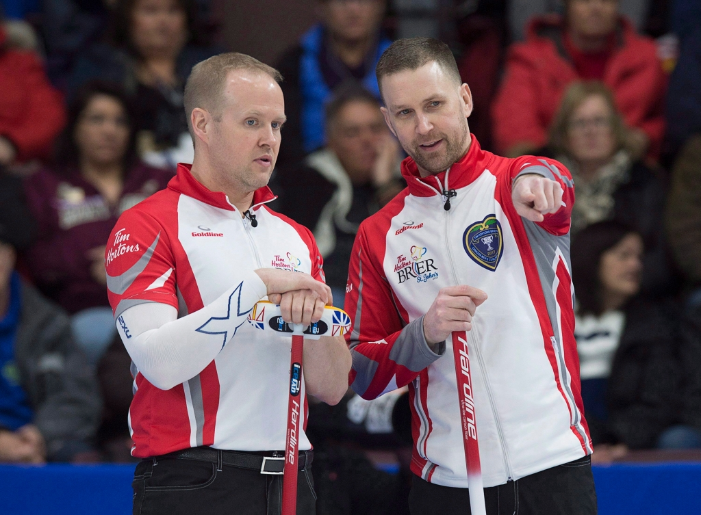 Brad Gushue and Mark Nichols discuss a shot