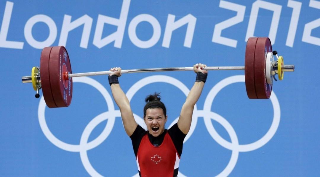 Christine Girard lifting weight above head