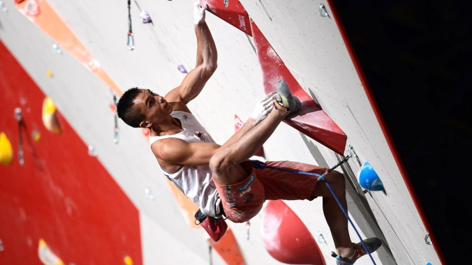 Sean McColl competes in lead climbing