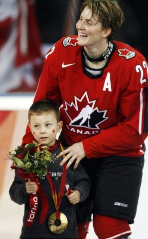 Team Canada's Hayley Wickenheiser puts her gold medal on her son, Noah, after defeating Sweden 4-1 to win the gold medal in womens ice hockey at the 2006 Winter Olympic Monday, Feb. 20, 2006 in Turin. (CP PHOTO/Ryan Remiorz)