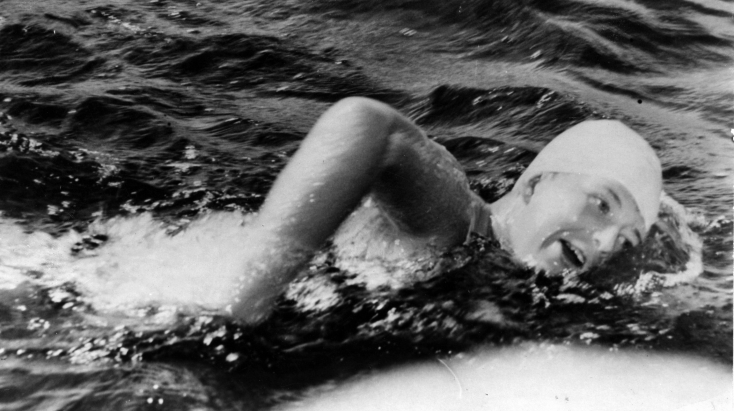 September 10, 1954 - Marilyn Bell, 16, during her epic 32 mile swim across Lake Ontario from Younstown, N.Y. to Toronto, Ontario. (AP)