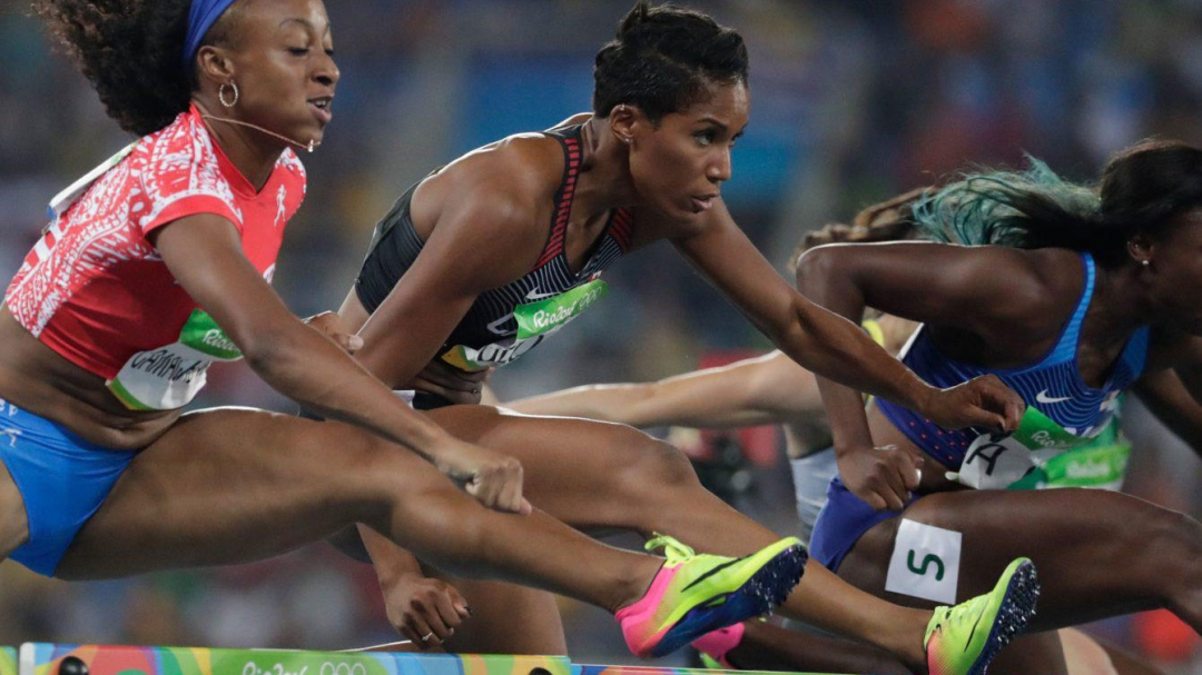 Runners competing in hurdles