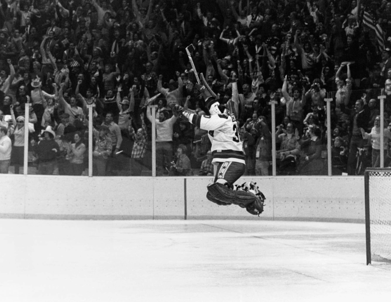 In this Feb. 22, 1980 file photo, U.S. Goalie Jim Craig leaps high in the air at the final second of game as the US Olympic hockey team won over the Soviet team 4-3 in Lake Placid. (AP Photo, File)
