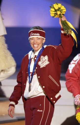 Canada's Beckie Scott, of Vermilion, Alberta acknowledges the crowd after receiving the Olympic bronze medal for her performance in the women's 5km free pursuit at Medals Plaza in downtown Salt Lake City, Feb. 15, 2002. (AP Photo/Darron Cummings)