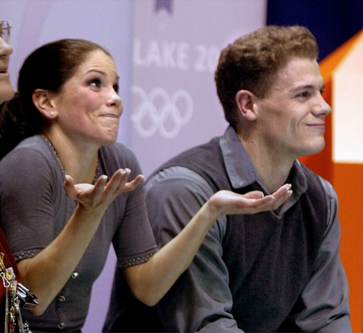 Canadian figure skaters Jamie Sale and David Pelletier react to their scores after competing in the pairs free program in the Olympic Winter Gamess at the Salt Lake Ice Center in Salt Lake City, Monday, Feb. 11, 2002. (AP Photo/Lionel Cironneau)