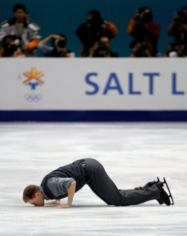 Canadian figure skater David Pelletier kisses the ice after competing in the pairs free program in the Olympic Winter Games at the Salt Lake Ice Center in Salt Lake City, Monday, Feb. 11, 2002. (AP Photo/Roberto Borea)