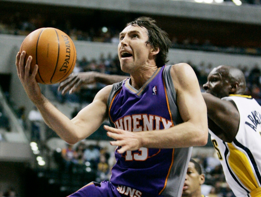 Phoenix Suns guard Steve Nash of Canada, left, puts up a shot against Indiana Pacers' Darrell Armstrong during the first quarter of an NBA basketball game in Indianapolis, in this Feb. 27, 2007 file photo. (AP Photo/Darron Cummings)