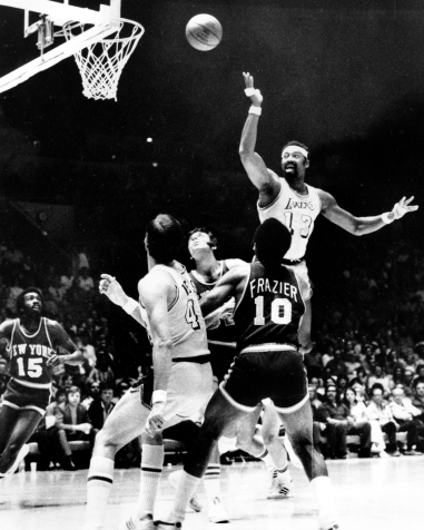 Wilt Chamberlain fires a leaping scoop shot against the New York Knicks in an NBA Finals basketball game in Los Angeles, 1972. (AP Photo/File)