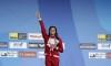 Masse breaks 100m backstroke world record to win world title