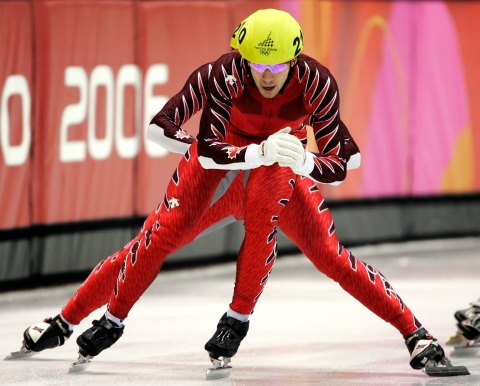 Canada's Charles Hamelin gets a push from his teammate Francois-Louis Tremblay during the men's 5000m relay semifinals at the Short Track Speed Skating race at the Turin 2006 Olympic Winter Games in Turin, Italy, Wednesday, Feb. 15, 2006. (AP Photo/Amy Sancetta)
