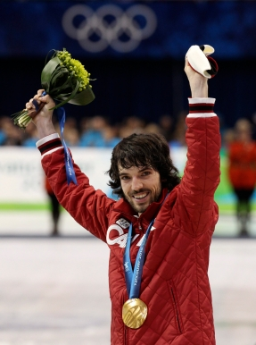 Canada's Charles Hamelin reacts on the podium after winning the gold medal for the men's 500m short track speed skating competition at the Vancouver 2010 Olympic Winter Games in Vancouver, British Columbia, Friday, Feb. 26, 2010. (AP Photo/Mark Baker)