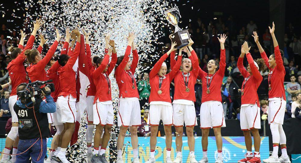 Female basketball players celebrating