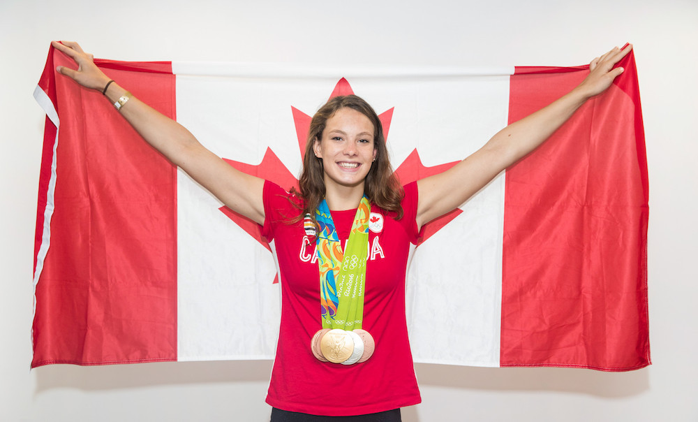 Penny Oleksiak poses with her four medals from Rio 2016.