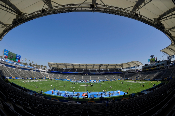 Players for the Seattle Seahawks and the Los Angeles Chargers walk on the field before a preseason NFL football game at the StubHub Center, Sunday, Aug. 13, 2017, in Carson, Calif. (AP Photo/Mark J. Terrill)