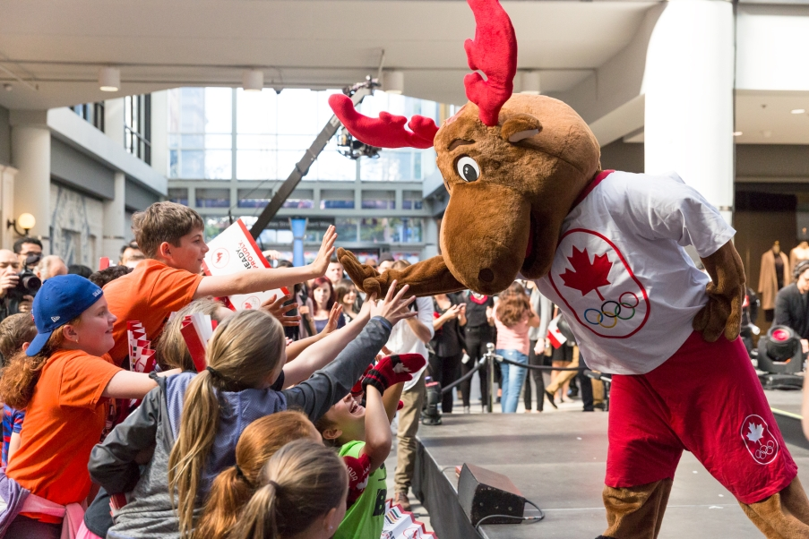 Team Canada's mascot Komak greets kids in the audience before Hudson's Bay reveal of the Canadian Olympic and Paralympic athlete clothing kit for the upcoming 2018 Winter Games in Pyeongchang. (Photo by Adam Pulicicchio)
