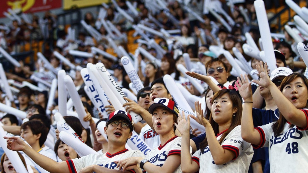 Team Canada - fans of the South Korean baseball team Doosan Bears sing songs while performing dance routines at Jamsil Stadium in Seoul, South Korea.