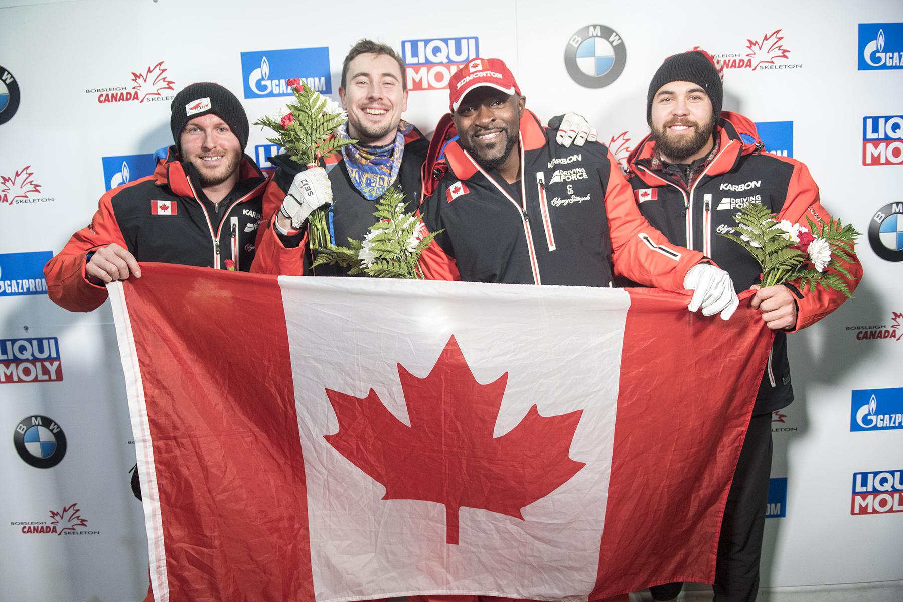 Team Canada - Justin Kripps, Alexander Kopacz, Neville Wright, and Chris Spring celebrate their 1-2 finish